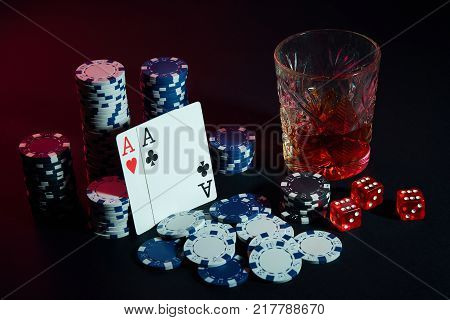 Poker cards with cubes are beautifully placed on the table, against the background of poker chips. Still life. The concept of gambling. Poker Online. Cards - two aces poster