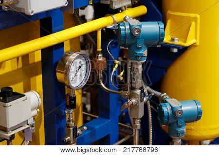 Industrial technological equipment with pipes and manometers.