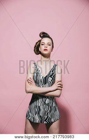 Girl In Stylish Vintage Dress On Pink Background.