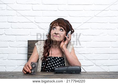 Granny dj in headset with cassette player. Audio book and new technology education. Old school music player radio. Spy and operator. Old woman with cassette recorder listen music in headphones.