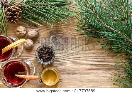Two glass of mulled wine with cinnamon sticks, slice of oranges and apple, star anise on a wooden table. Top view. Still life. Copy space. Flat lay. Christmas hot drink