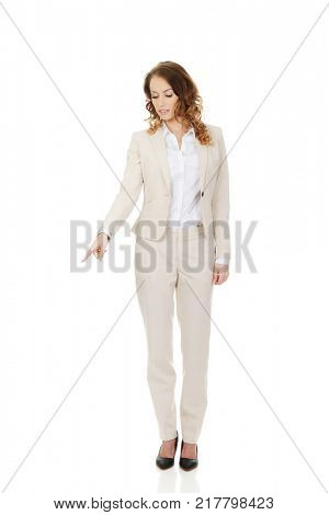 Businesswoman pointing down.