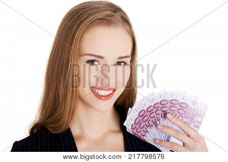 Beautiful caucasian business woman holding euro currency.