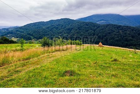 Haystack On Rural Field In Mountains