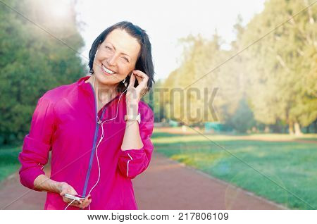 Close Up Portrait Of Mature Woman Weared In Sports Clothes In The Park