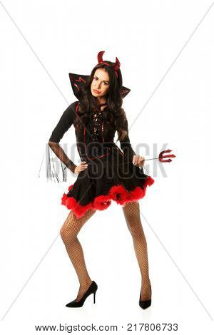 Woman wearing devil clothes holding trident