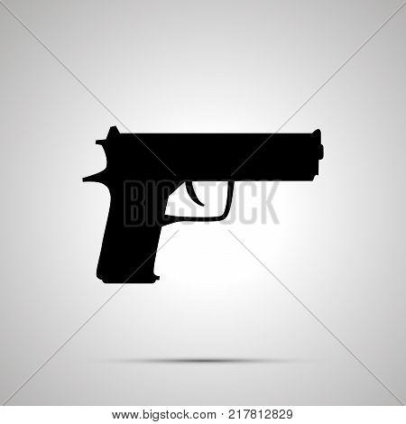 Gun silhouette simle black icon with shadow