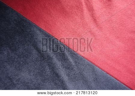 Cerise and dark blue artificial suede sewn together diagonally