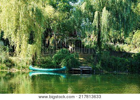 Boat floating on the Krka river in Kostanjevica na Krki Slovenia