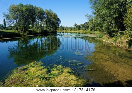 Calm Krka river in Kostanjevica na Krki Slovenia