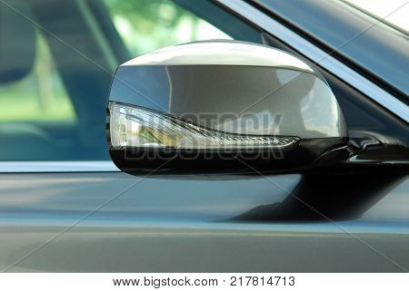 Car rear-view mirror with blinker, exterior detail