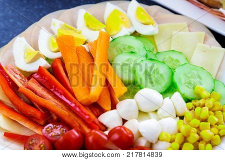 Buffet catering food with cucumber carrot tomatoes egg and others vegatables arangement on table.