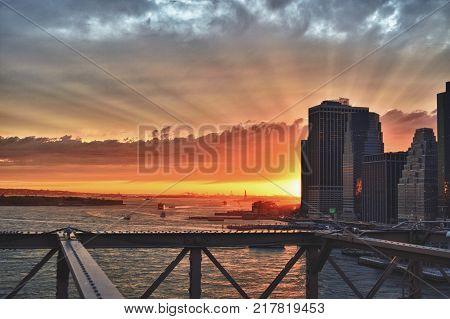 Beautiful sunset over a Manhattan taken from Brooklyn Bridge - HDR view.