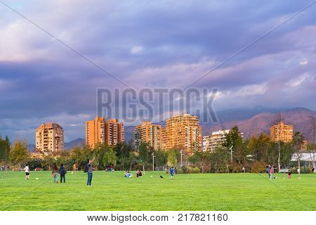 Santiago Region Metropolitana Chile - May 13 2017: People gather practice sports and walk their dogs at Parque Juan Pablo II an extension of Parque Araucano forming the the mayor urban park in Las Condes district.
