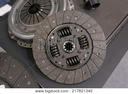 View on new clean car truck clutch component part detail. Car clutch disc disk parts details components for maintenance repair. Car clutch disc spare parts. Truck clutch disc