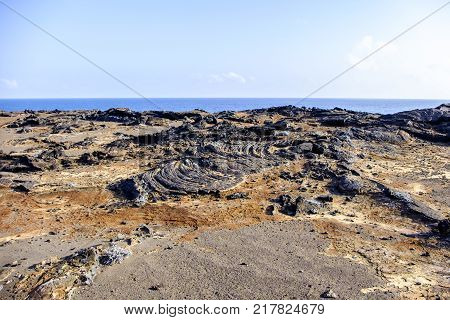 Barren landscape of Galapagos Islands with shapes and textures of black lava rock