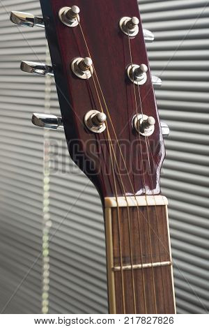Close up to the tuning keys of an acoustic guitar
