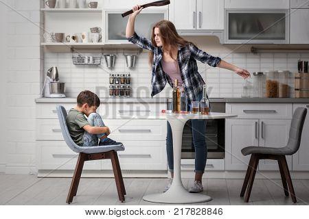 Drunk woman threatening her son in kitchen