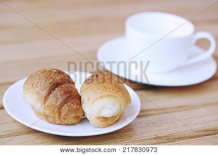 Homemade croissant . Delicious fresh croissant on wood table. Selective focus