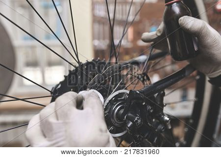 Repair technician bicycles was repaired gear bike shop. Bike Mechanic.