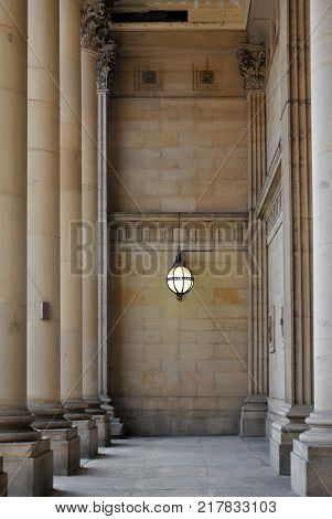 leeds town hall entrance with stone pillars and Victorian lamp