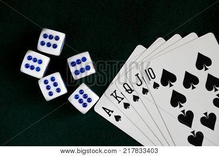 White bones thrown on the table, a Royal flush of spades. Dark green cloth. poster