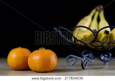 Tasty Fruits In A Metal Basket. Wire Basket With Fruits On A Wooden Table.