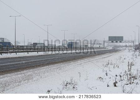 Hemel Hempstead UK - December 10 2017:Traffic on the British motorway M1 during the snowstorm