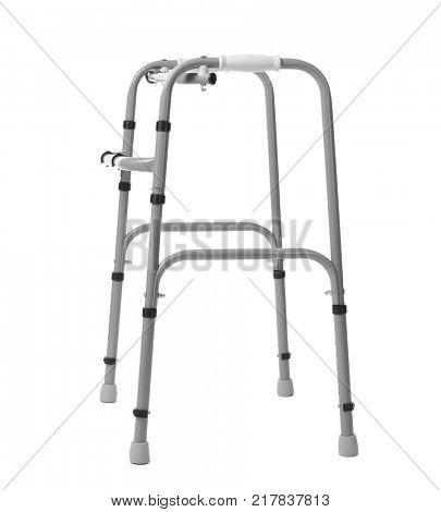 Metal walking frame on white background