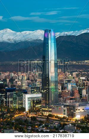 Santiago Region Metropolitana Chile - December 26 2016: View Gran Torre Santiago the tallest building in Latin America a 64-story tall skyscraper with a view of ski centers in the back on The Andes mountains.