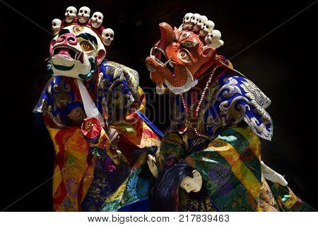 Dance Cham, Dance Buddhist monks high tantric initiations in bright clothes and Masks White Mahakala and orange Makara, Tibet, picture from the mystery in Karcha Gonpa.