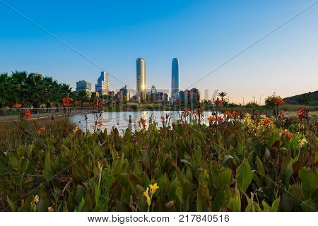 Pond at Bicentennial Park in the wealthy Vitacura district and skyline of buildings at financial district Santiago de Chile poster