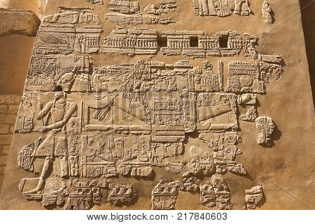 Egyptian Hieroglyphs And Drawings On The Walls And Columns. Egyptian Language, The Life Of Ancient G