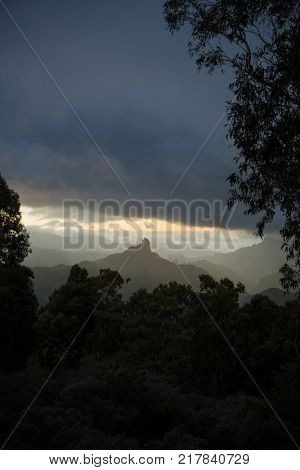 Roque Bentayga Monolith rocky mountains in Gran Canaria at sunset