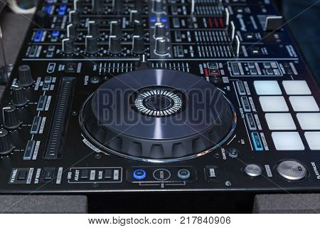DJ console cd mp4 deejay mixing desk music party in nightclub. DJ console for experiments with music