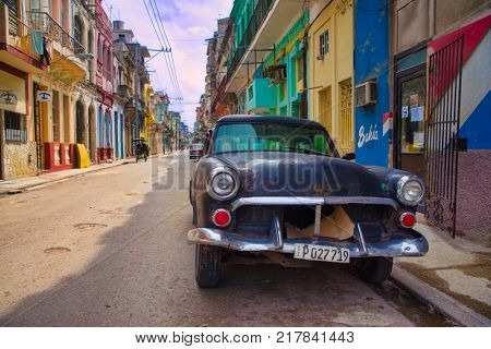 HAVANA, CUBA - 16 FEB, 2017. Black vintage classic American car, commonly used as private taxi parked in Old Havana street.