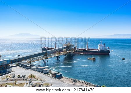 Antofagasta Antofagasta Region Chile - April 19 2017: Cargo ship docked at Puerto Coloso an alternative port from the port of Antofagasta serving mining shipments from Escondida Mine.