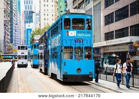 HONG KONG - APRIL 3 , 2016: Unidentified people using tram in Hong Kong on April 3, 2016. Hong Kong tram is the only one in the world run with double deckers and one of the main tourist attractions.