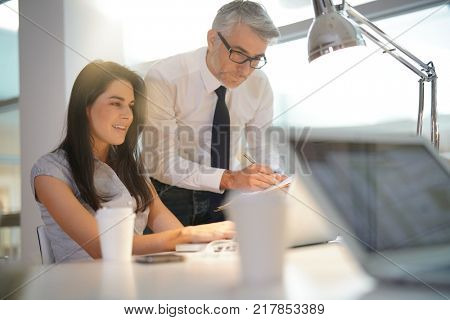 Manager talking to co-worker about sales target
