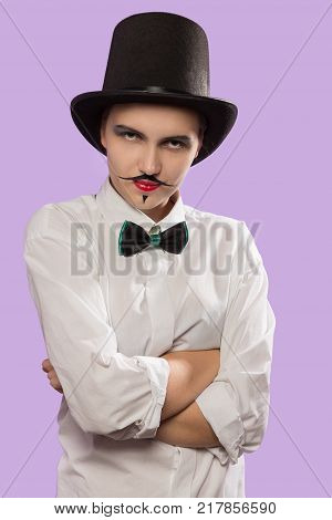 fun serious woman with hat tie and mustache at pink background looking at camera