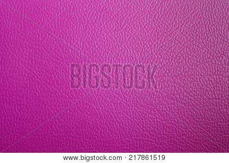 The space on pink leatherette for you text.