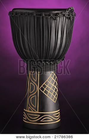 Djembe Drum Isolated On Purple Spotlight