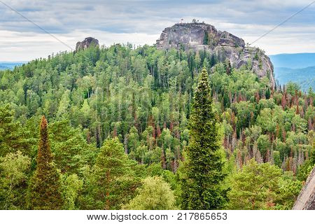 View of the Second pillar with inscription Freedom. Central pillars of Russian reserve Stolby Nature Sanctuary. Near Krasnoyarsk