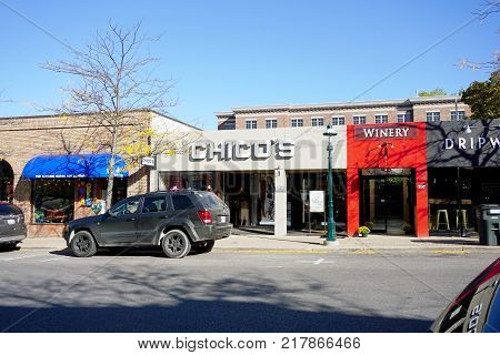 PETOSKEY, MICHIGAN / UNITED STATES - OCTOBER 18, 2017: One may buy women's clothing at Chico's, and taste wine from the Petoskey Farms Vineyard and Winery, on Howard Street in downtown Petoskey.