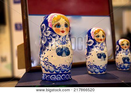 Russian nesting dolls, a puppet set, a Russian tradition, a Russian landmark, a grandmother's daughter and grandchildren