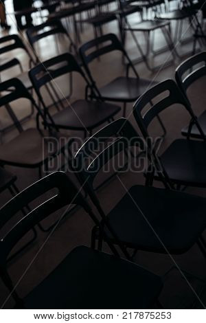 conference hall with Black empty chairs in row