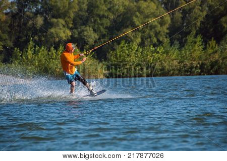 Concentrated Man Trains On A Wakeboard