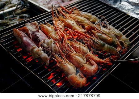 Fresh shrimp grilled on stove at night market Hua Hin Thailand