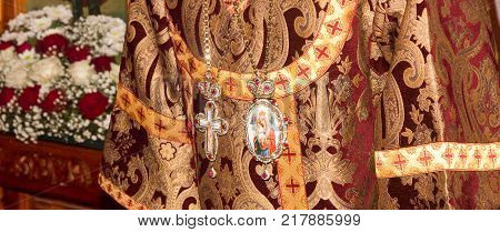 Adygea Russia - November 8 2017: The festive vestments of the Archbishop with a crucifix and a Panagia with an image of the virgin Mary