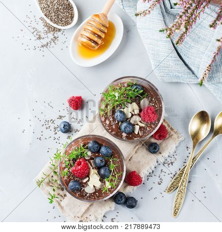Healthy Vegan Chocolate Chia Pudding With Berries And Green Thyme